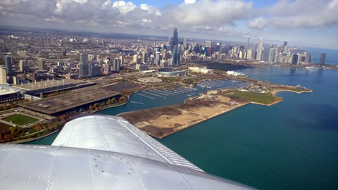 photo of Chicago skyline flying over it